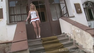 Desirable golden-haired likes her fresh white suit