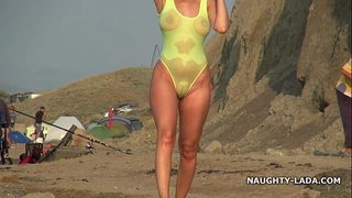 Transparent swimsuit and exposed on the beach