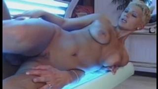 Busty golden-haired girlfriend sucks and copulates in a solarium