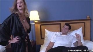 Sexy milf strokes a youthful rod