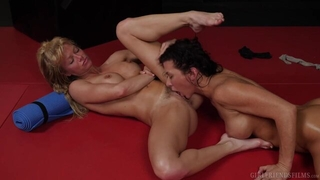 Two nymphomaniac lesbians fucking wildly on the floor