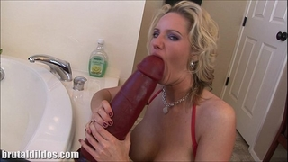 Busty golden-haired milf zoe fills her wet crack with a massive sextoy